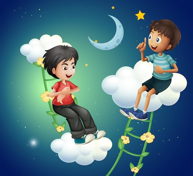 Dwóch Chłopców Rozmawia W Pobliżu Księżyca Darmowych Wektorów