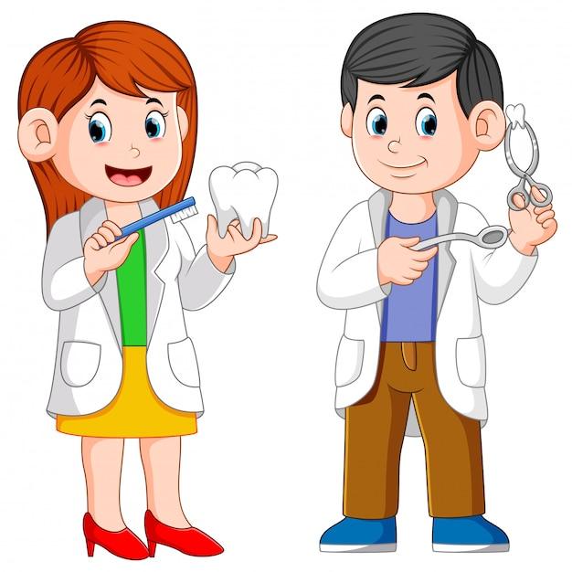 Dwoje dentystów trzyma narzędzia do praktyki Premium Wektorów