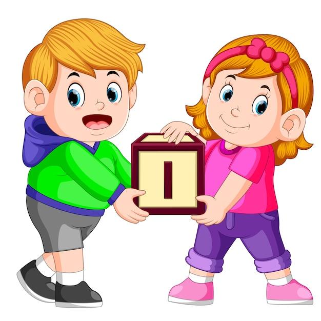 Dwoje Dzieci Niosących Alfabet Blok Premium Wektorów