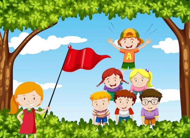 Dzieci Bawią Się W Parku W Ludzką Piramidę Darmowych Wektorów