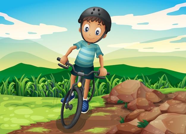 Dzieciak na rowerze na szczycie wzgórza Darmowych Wektorów