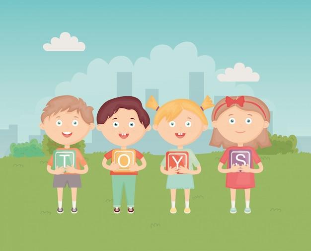 Dzieciaki trzyma bloki z abecadłem w parku, zabawki Premium Wektorów