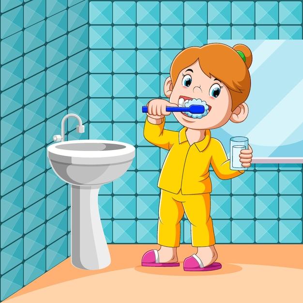 Dziewczyna Myje Zęby W Toalecie Przed Snem Premium Wektorów