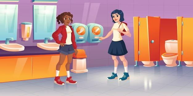 Dziewczyny W Publicznej Toalecie Z Automatami Z Tamponami I Ochraniaczami. Kreskówka Wnętrze Toalety Szkolnej, Toalety Z Miską Wc, Umywalką I Lustrami. Młoda Kobieta Z Miesiączką W Toalecie Kobiet Darmowych Wektorów