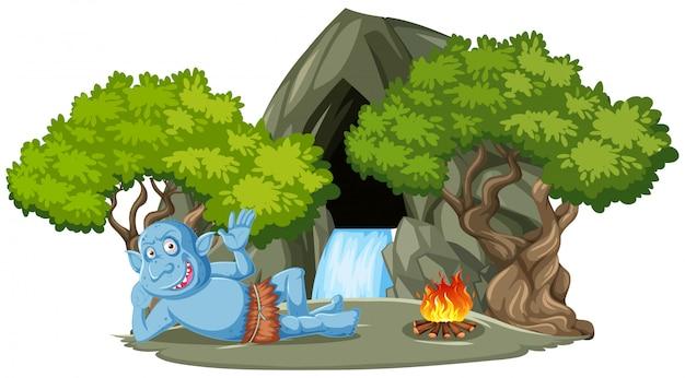 Goblin Lub Troll Leżącego Przed Kamiennej Jaskini Z Drzewnym Stylu Kreskówka Na Białym Tle Darmowych Wektorów