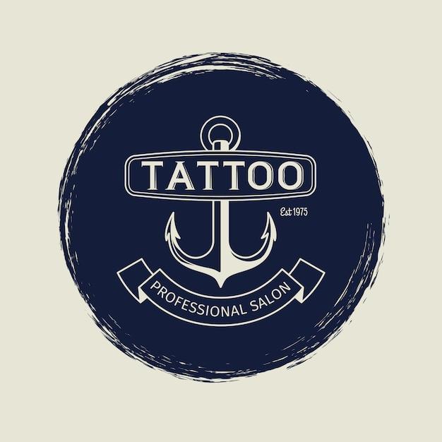 Godło salonu vintage tatuaż z kotwicą Premium Wektorów