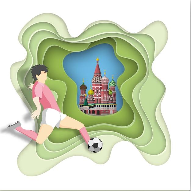 Gracz piłki nożnej kopie piłkę na tle moskwy Premium Wektorów