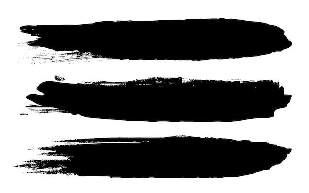 Grunge czarne szorstkie pociągnięcia pędzlem. Premium Wektorów