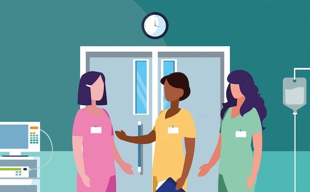 Grupa lekarzy kobiet w sali operacyjnej Premium Wektorów