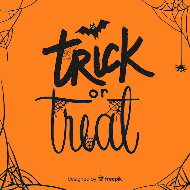 Halloweenowy napis w pomarańczowych odcieniach z pajęczynami Darmowych Wektorów