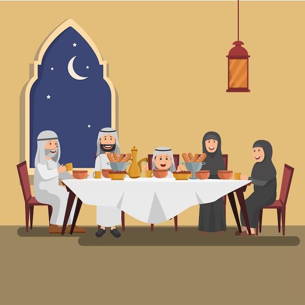 Ilustracja arabska rodzina cieszy się iftar Premium Wektorów