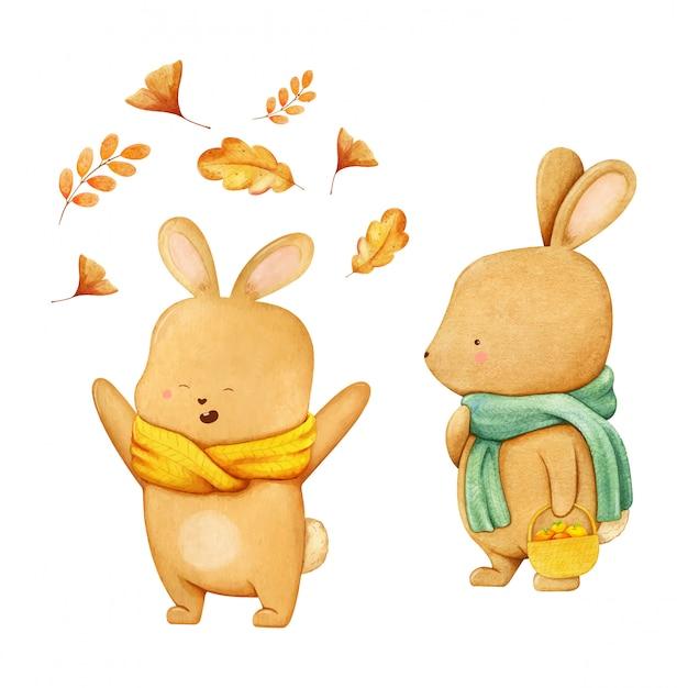 Ilustracja Postaci Zająca W Zielonym Szaliku Z Busketem Pełnym Jabłek I Szczęśliwego Chłopca Zająca W żółtym Szaliku Bawiącym Się Opadającymi Jesiennymi Liśćmi. Ręcznie Rysowane Akwarela Premium Wektorów