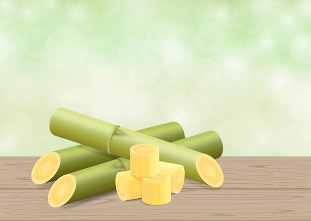 Ilustracyjna trzcina cukrowa, trzcina na drewno stole i zielony miękki bokeh natury tło Premium Wektorów