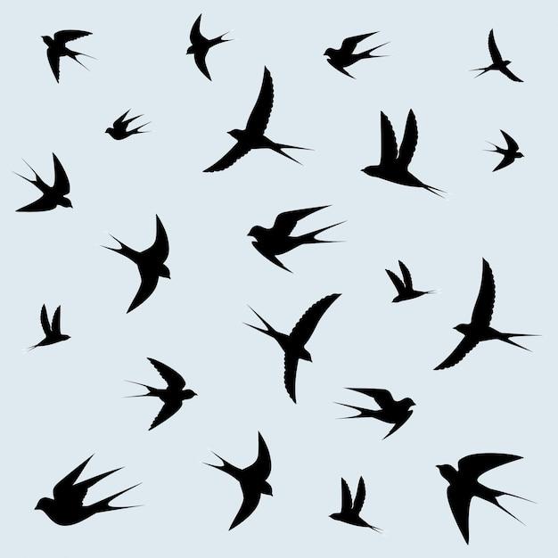 Jaskółki latające na niebie Premium Wektorów