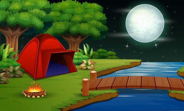Kemping w nocy z pięknym widokiem na przyrodę Premium Wektorów