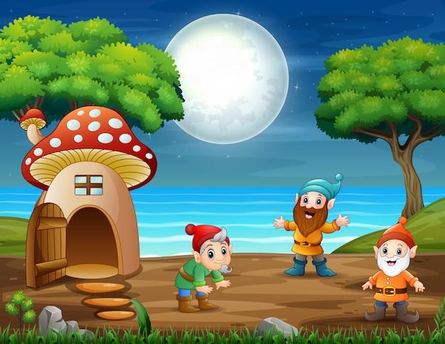 Kilka Zabawnych Krasnali W Lesie W Nocy Premium Wektorów