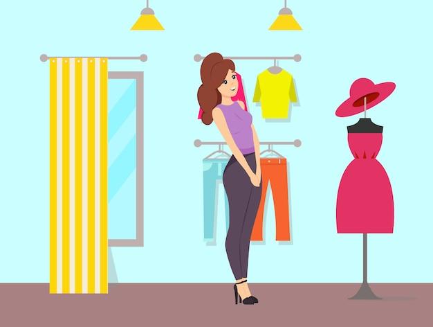 Kobieta, podziwiając sukienkę i kapelusz na manekinie Premium Wektorów