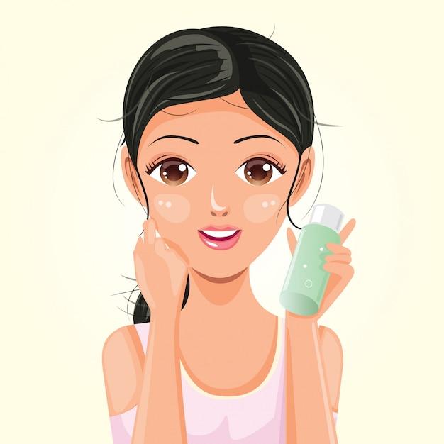 Kobieta z butelką esencji Premium Wektorów
