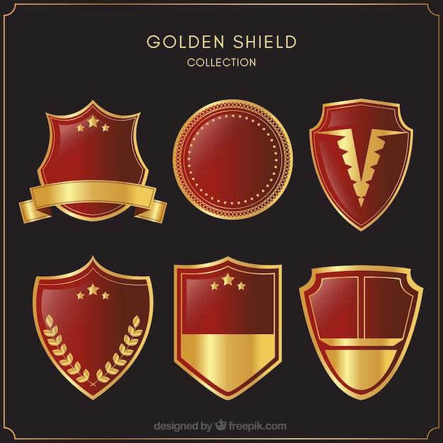 Kolekcja czerwone i złote tarcze Darmowych Wektorów