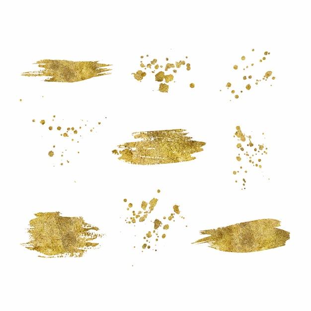 Kolekcja złotych pociągnięć pędzlem splatters na białym tle Darmowych Wektorów