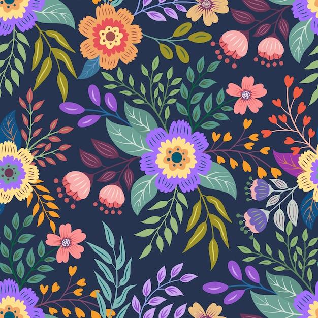 Kolorowe ręcznie rysowane bezszwowe tło wzór kwiatowy. wektorowa ilustracja bezszwowy kwiecisty wzór. Premium Wektorów