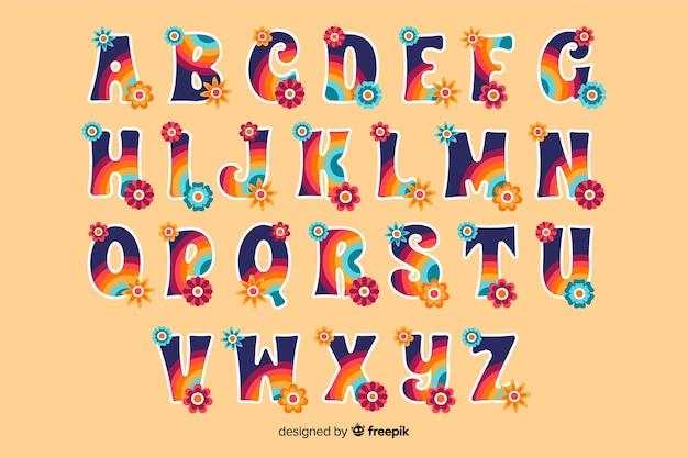 Kolorowy kwiatowy alfabet w stylu lat 60-tych Darmowych Wektorów