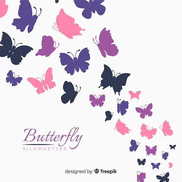 Kolorowy motyl sylwetki tło Darmowych Wektorów