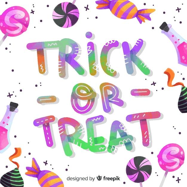 Kolorowy napis cukierek albo psikus z cukierkami Darmowych Wektorów
