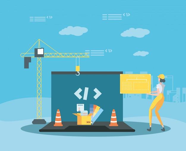Konstruktor i laptop z budowaną stroną internetową Premium Wektorów