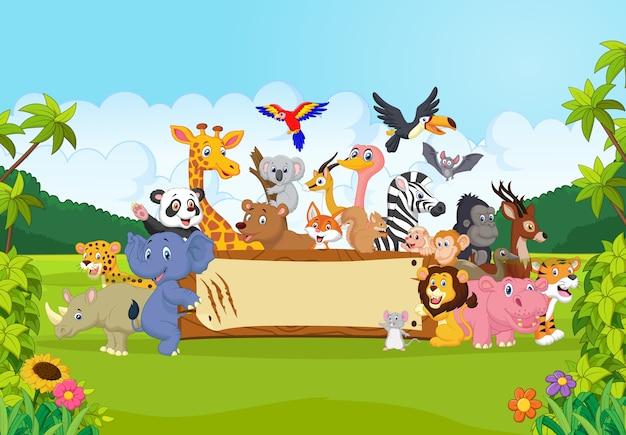 Kreskówka dzikich zwierząt, trzymając transparent Premium Wektorów