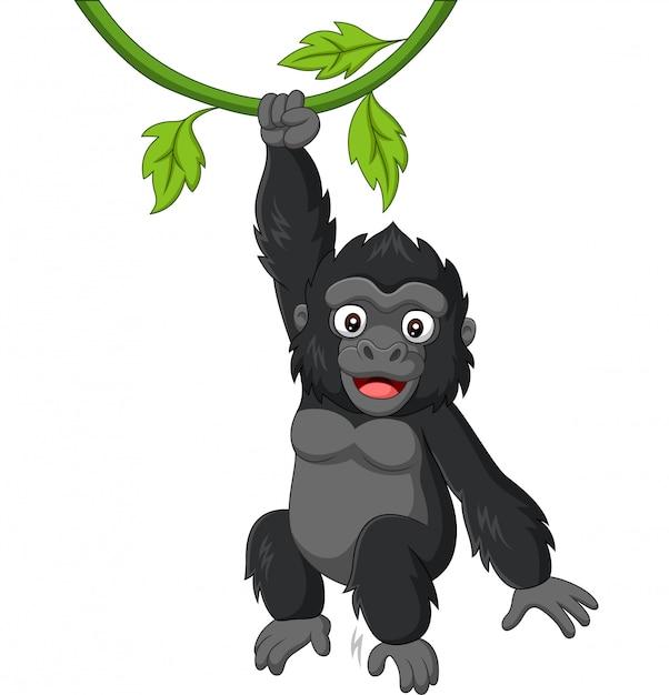 Kreskówka goryl dziecko wiszące w gałęzi drzewa Premium Wektorów