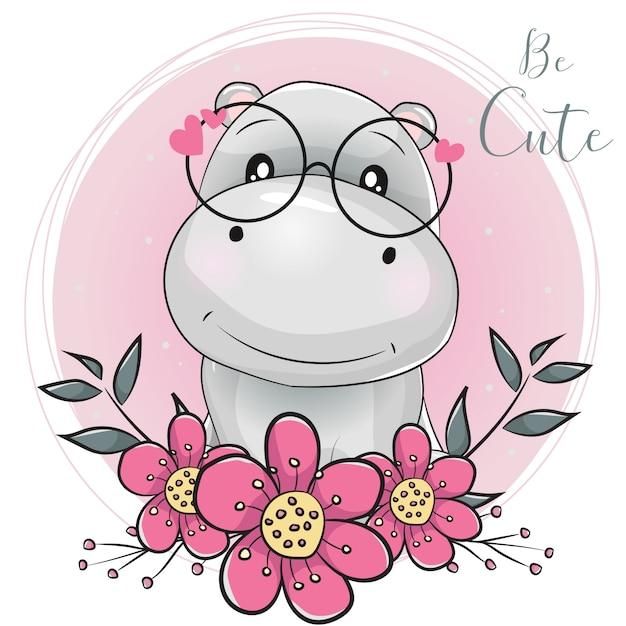 Kreskówka hipopotam z kwiatami z różowym tle Premium Wektorów