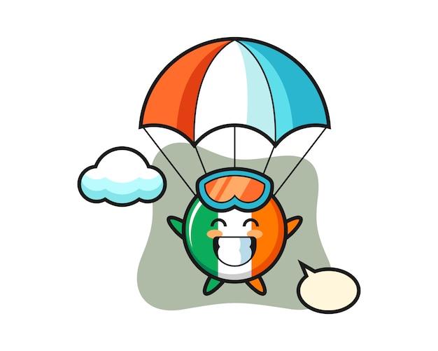 Kreskówka Maskotka Flaga Irlandii Skacze Ze Spadochronem Ze Szczęśliwym Gestem Premium Wektorów