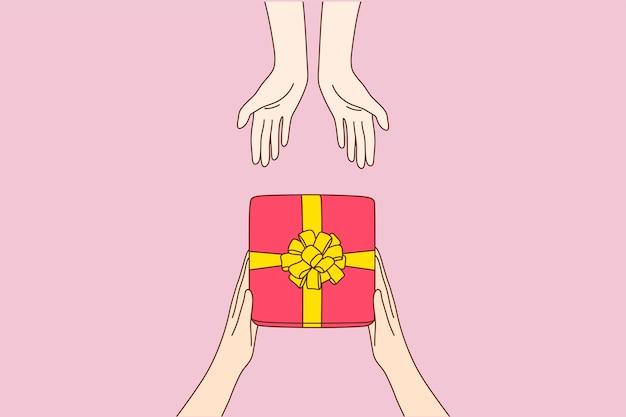 Kreskówka Mężczyzna Ręce Dając Czerwone Pudełko Ze Złotą Wstążką W Ramionach Kobiety Premium Wektorów