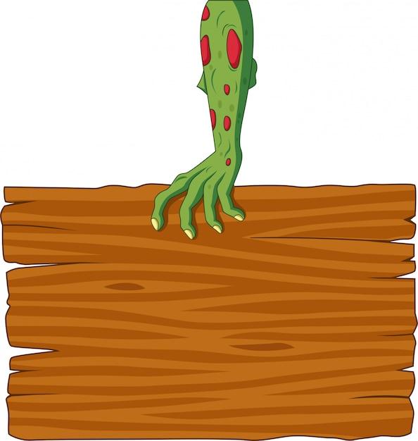 Kreskówka zombie ręka trzyma pusty znak Premium Wektorów