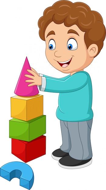 Kreskówki Chłopiec Bawić Się Z Elementami Premium Wektorów