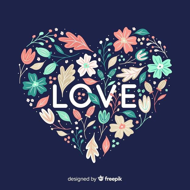 Kształt serca z kwiatami na niebieskim tle Darmowych Wektorów
