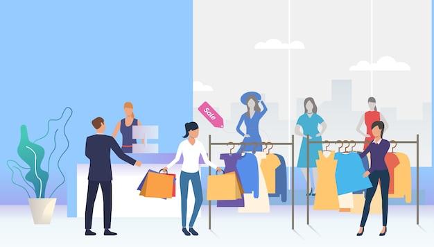 Kupujący wybiera i kupuje ubrania w sklepie Darmowych Wektorów