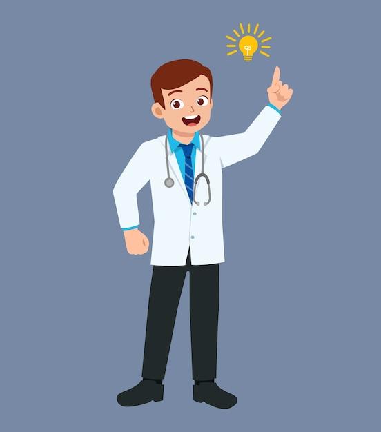 Ładny, Dobrze Wyglądający Młody Lekarz Stojący Ze Znakiem żarówki Premium Wektorów