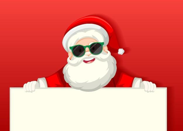 Ładny święty Mikołaj W Okularach Przeciwsłonecznych Postać Z Kreskówki Trzymając Pusty Transparent Na Czerwonym Tle Darmowych Wektorów