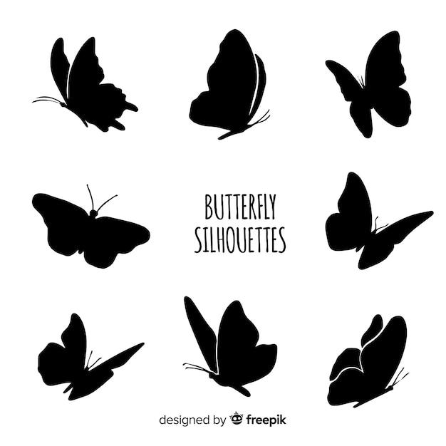 Latające motyle sylwetki Darmowych Wektorów