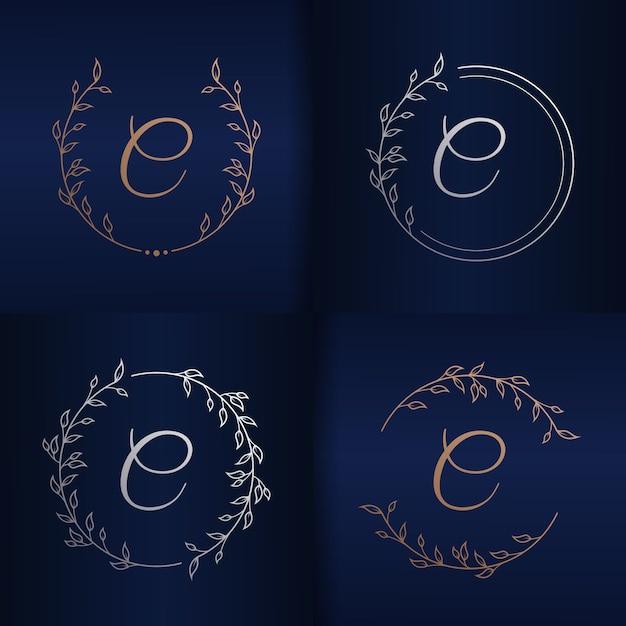 Litera E Z Szablonem Logo Kwiatowy Ramki Premium Wektorów