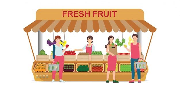 Lokalny sklep z owocami na rynku rolnym ze sprzedawcą owoców. Premium Wektorów