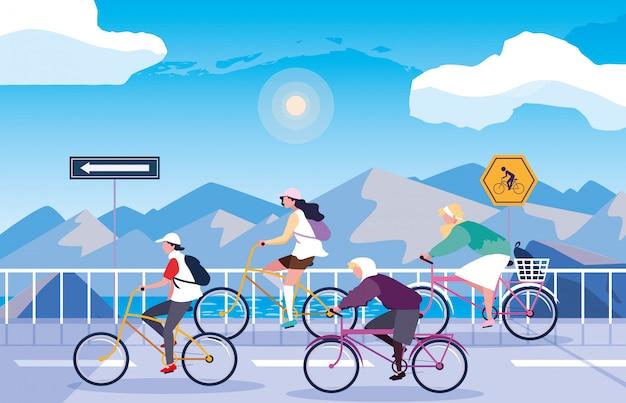 Ludzie jadący rowerem w snowscape z oznakowaniem dla rowerzysty Premium Wektorów