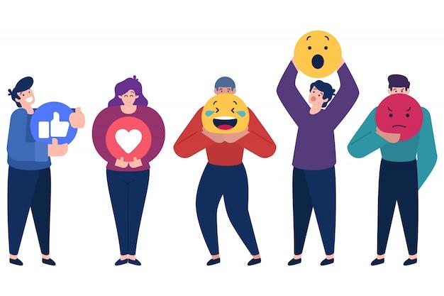 Ludzie trzymający emotikon Premium Wektorów