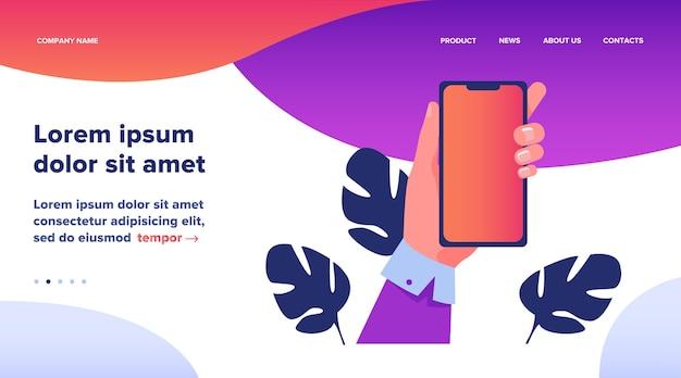 Ludzka Ręka Trzyma Telefon Komórkowy. Osoba Korzystająca Z Aplikacji Na Ilustracji Wektorowych Płaski Smartphone. Projekt Strony Internetowej Lub Strona Docelowa Technologii Darmowych Wektorów