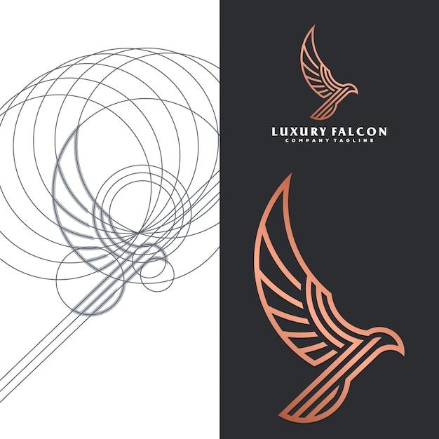 Luksusowe logo sokoła Premium Wektorów