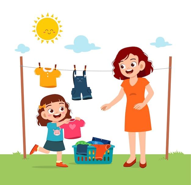 Małe Dziecko Pomaga Matce Wysuszyć Ubrania Na Zewnątrz Premium Wektorów