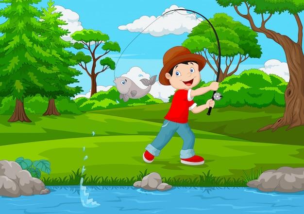 Mały chłopiec połowów na jeziorze Premium Wektorów
