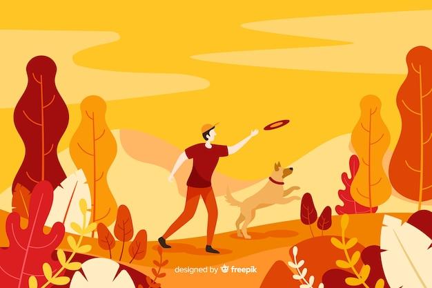 Mężczyzna bawić się z jego psem na jesieni tle Darmowych Wektorów